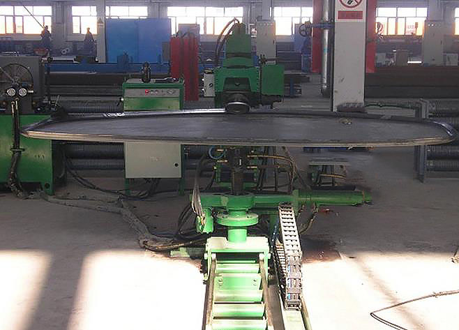 Abnormity flat-bottomed dished end folding machine flange machine(图1)